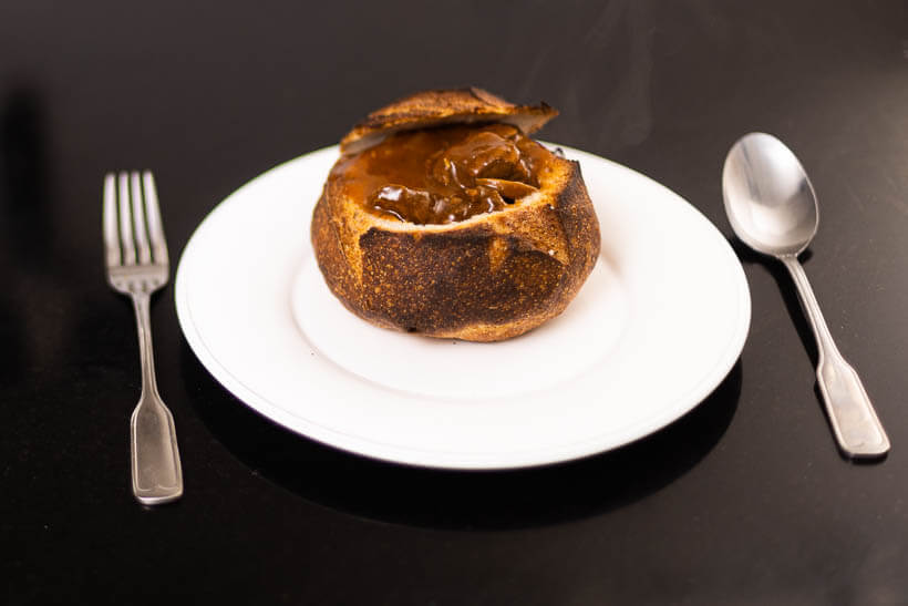 Hungarian goulash served in a sourdough bread bowl