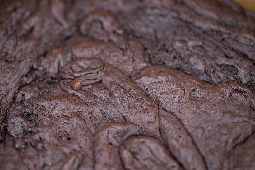 Thin papery skin on a perfect fudgy sourdough brownie