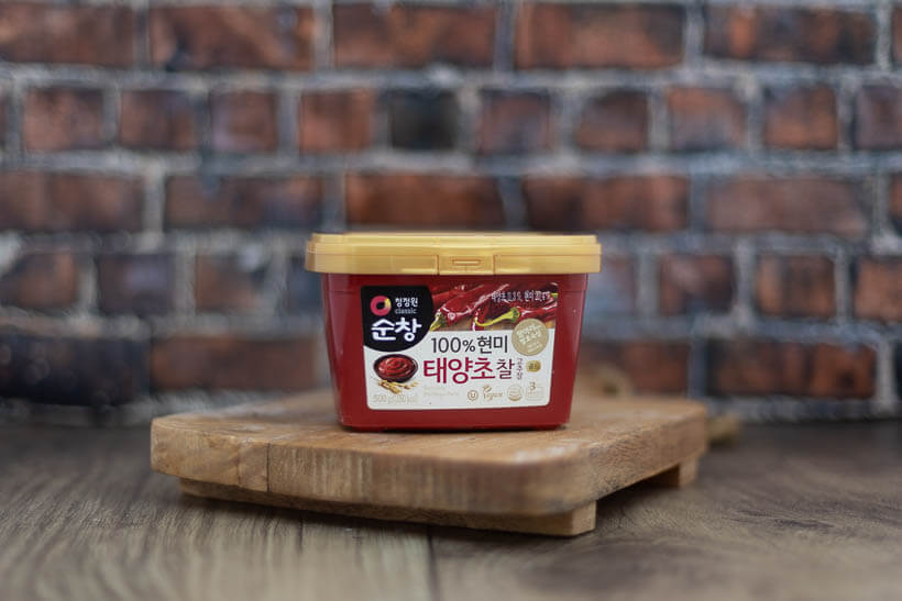 Korean red chili paste, gochujang, on a board
