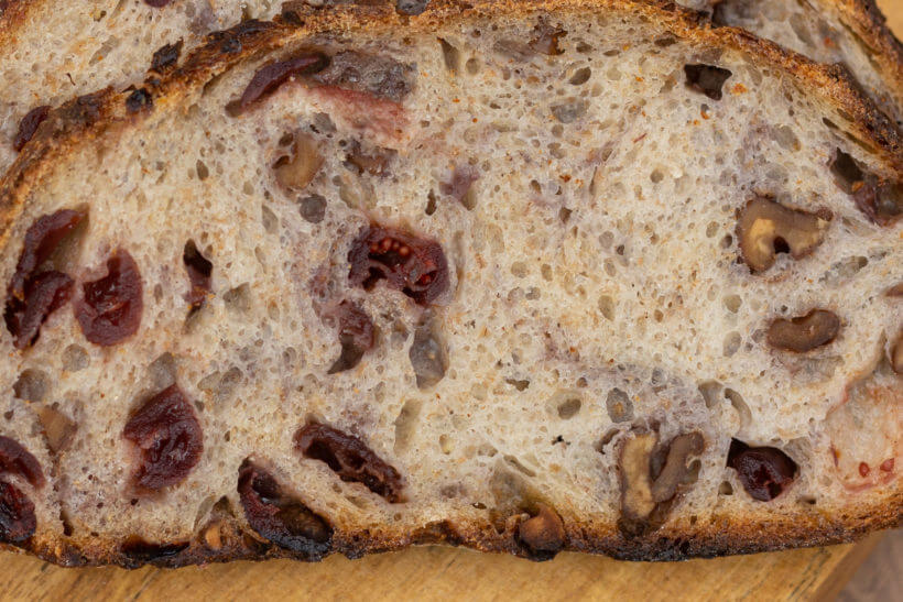 close up of the crumb in this sourdough walnut cranberry bread